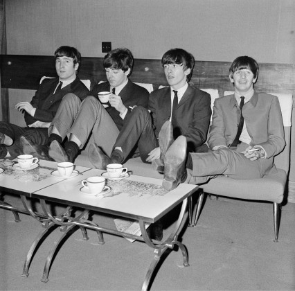 The Beatles relax backstage at London's Prince of Wales Theatre, before the Royal Variety Performance, 4th November 1963. They are supporting Marlene Dietrich in the show. (Photo by Mark and Colleen Hayward)