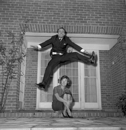 Dickie leaping over Dixie at home in Kensington on his 37th birthday, 1959.