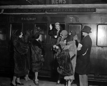 January 1931, American actress Miss Tallulah Bankhead pictured waving as she leaves Waterloo Station on a train, en route for the USA