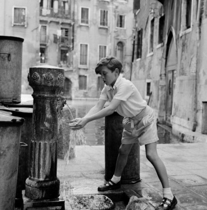 "David Hemmings, aged 12 enjoying Venice (drinking water from a fountain) between rehearsals of Benjamin Britten's new opera 'Turn of the Screw""."