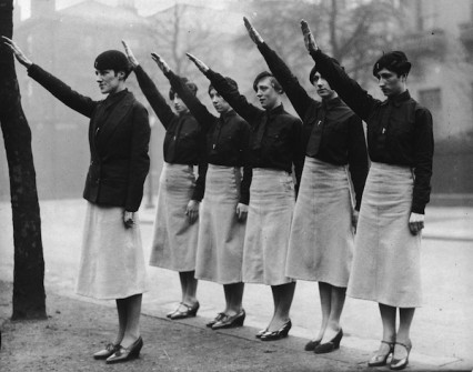 Women 'black-shirts'  from Sir Oswald Mosley's British Union of Fascists on parade give the fascist salute. Their uniform is a black shirt and tie, beret and slightly flared grey skirts.