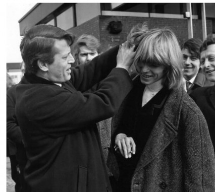 Bowie showing off his lovely long hair to Barry Langford 1965