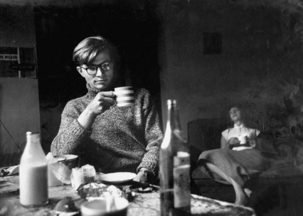 Colin Wilson drinking wine in a cup with girlfriend Joy
