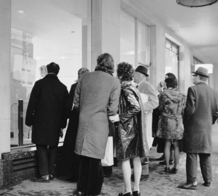 People looking at the Lennon exhibition at Eugene Schuster's London gallery in 1970
