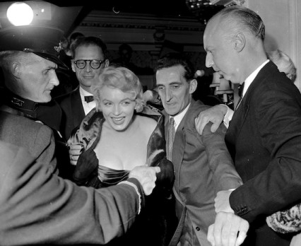 Marilyn in the crush outside the Comedy Theatre, October 1956