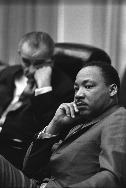 Martin Luther King with Lyndon Johnson in the background