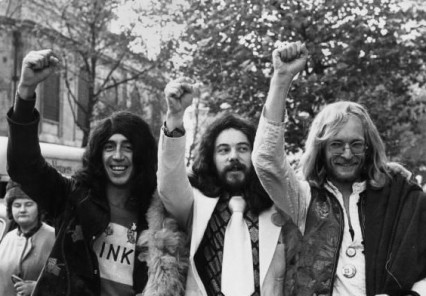 The wig-wearing Oz editors celebrating the outcome of the trial in November 1971
